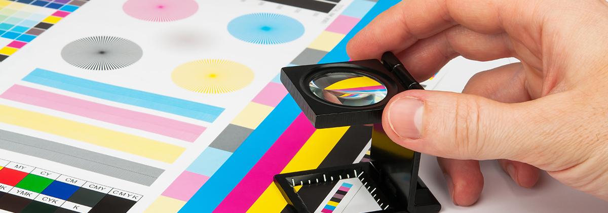 Technician examining print